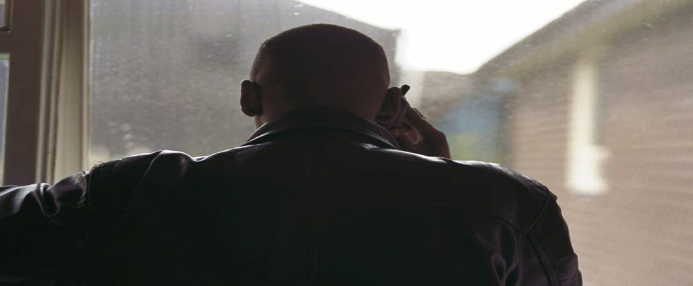 image of man on phone